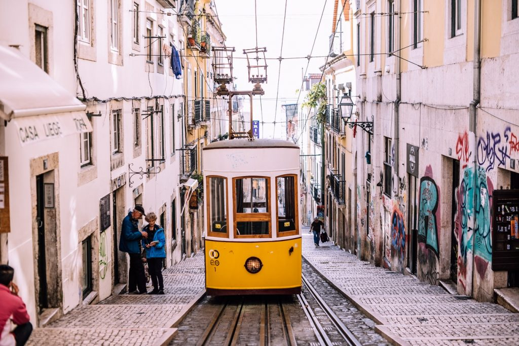 A tram in Lisbon on the cobbled streets